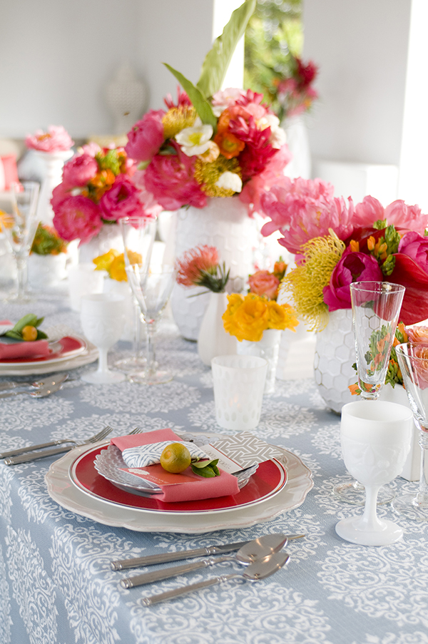 Patterned Table Linens with Bright Summer Flowers in Coral and Yellow | Angie Silvy Photography | Suite Retreat - Modern Wine Country Wedding Inspiration from Napa Valley Linens