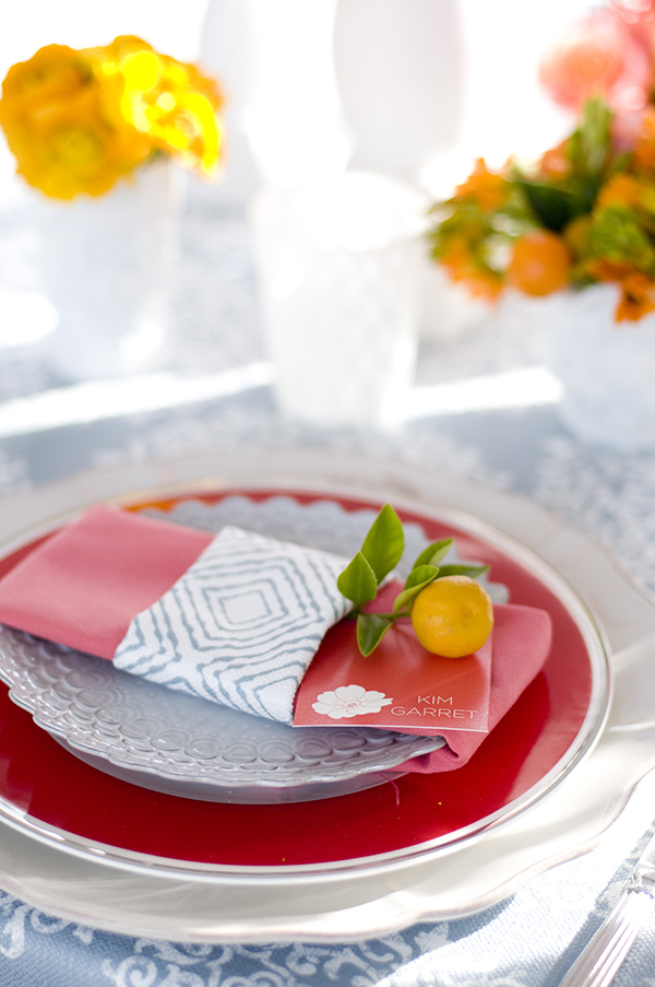 Geometric Print Band around a Coral Napkin for a Modern Place Setting | Angie Silvy Photography | Suite Retreat - Modern Wine Country Wedding Inspiration from Napa Valley Linens
