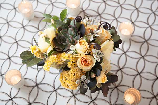 Black and White Patterned Linens with Sunny Yellow Centerpieces | Gina Peterson Photography | Modern Industrial Event Inspiration from ISES Napa-Sonoma