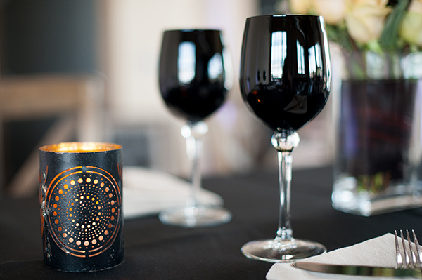Pierced Candle Holders with Black Wine Glasses | Gina Peterson Photography | Modern Industrial Event Inspiration from ISES Napa-Sonoma