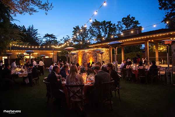 Romantic Outdoor Wedding Reception Under Bistro Lighting | Rhee Bevere Photography and Caitlin Arnold Weddings | Rustic Elegance for a Vineyard Wedding at The Vintage Estate