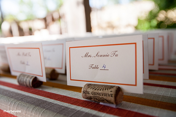 Wine Cork Escort Cards on Striped Linens | Rhee Bevere Photography and Caitlin Arnold Weddings | Rustic Elegance for a Vineyard Wedding at The Vintage Estate