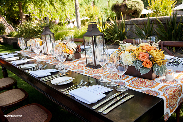 Patterned Table Runners on Wooden Farm Tables | Rhee Bevere Photography and Caitlin Arnold Weddings | Rustic Elegance for a Vineyard Wedding at The Vintage Estate