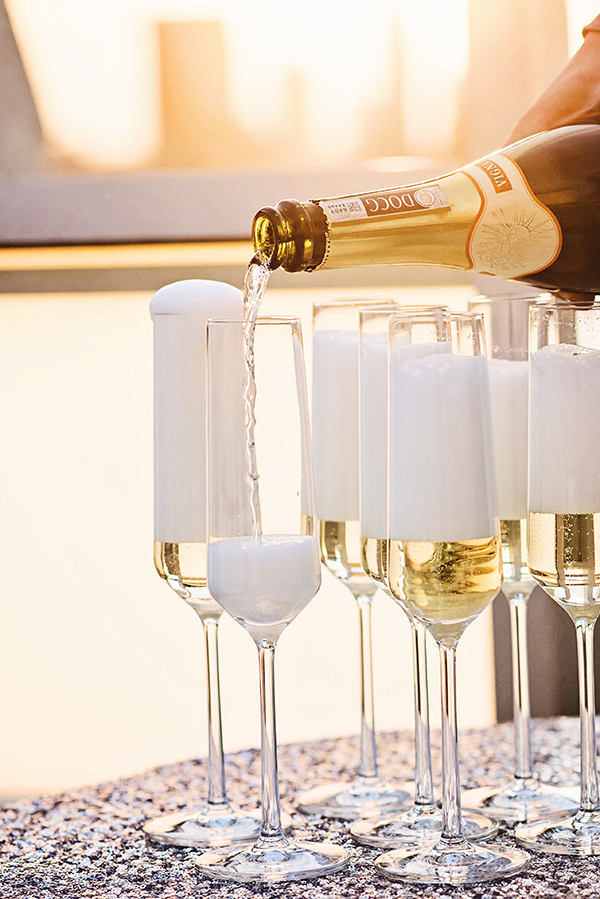 Champagne Flutes on Sparkling Silver Sequin Linens| Grace Aston Photography | Glamorous Rooftop Wedding Shoot in New York City