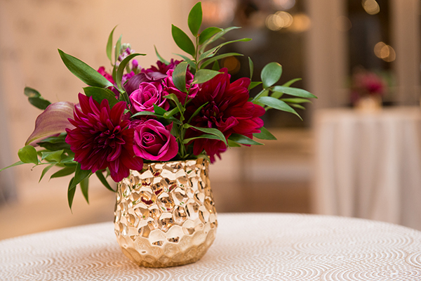 Red and Fuchsia Centerpiece on Patterned Gold Linens | Brian MacStay Photography | Tales of the Jazz Age - A Galia Lahav Preview at Kinsley James Couture Bridal Salon