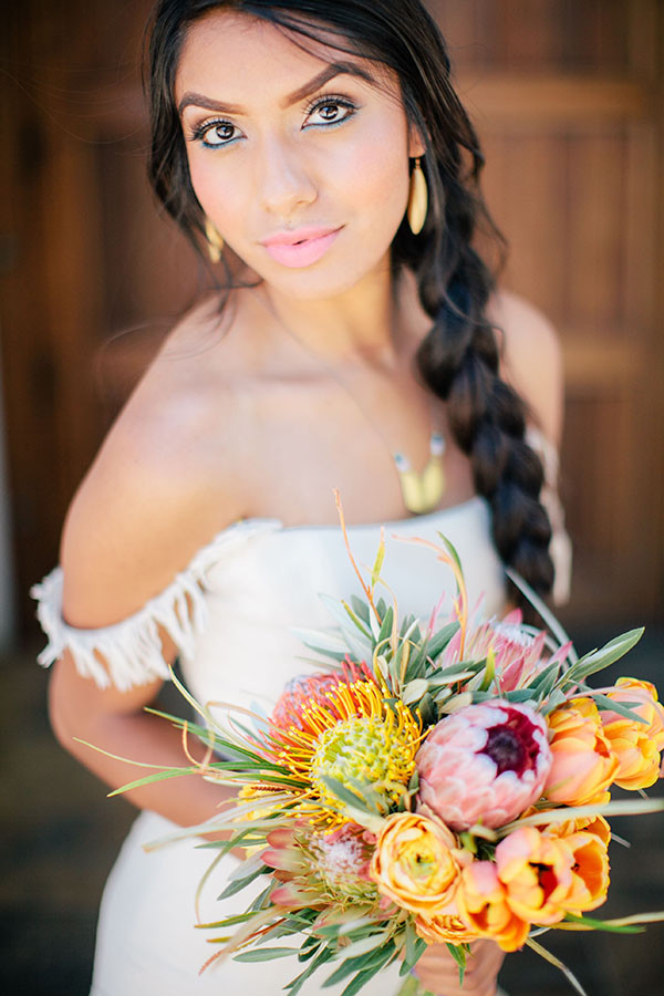 Fringed Wedding Dress with a Colorful Protea Bouquet | Clane Gessel Photography and Creative Flow Company | Colorful Southwestern Wedding Inspiration at Wente Vineyards