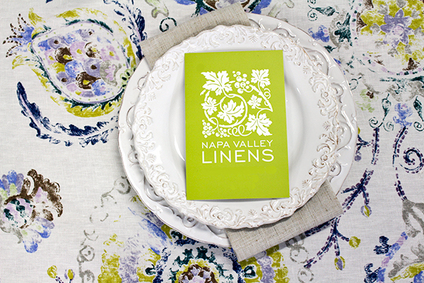 Wine Country Party Chargers with Natural Hemstitch Napkins | @heyweddinglady for @nvlinens | Pastels and Prints for our Spring Showroom Decor!