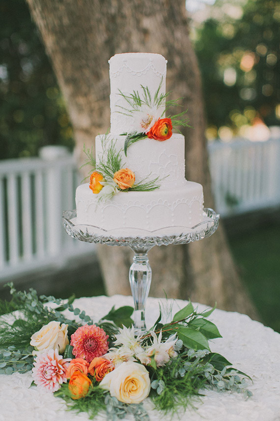 Simple White Tiered Wedding Cake with Bright Flowers | Fondly Forever Photography and Summer Newman Events | A Citrus Summer Wedding in Southern California