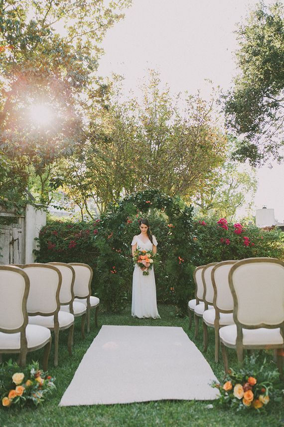 Elegant Outdoor Ceremony with a Greenery Arch | Fondly Forever Photography and Summer Newman Events | A Citrus Summer Wedding in Southern California