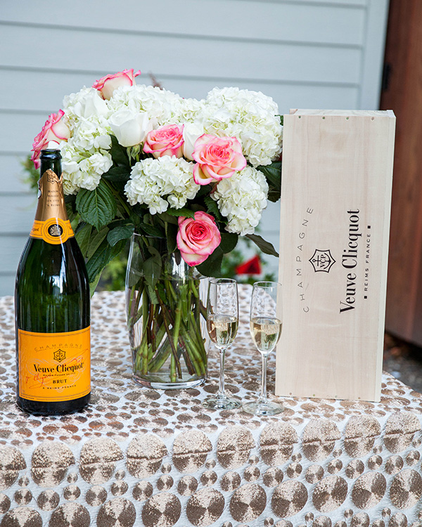 Champagne Display with Modern Gold Geometric Linens from @nvlinensChampagne Sequins and Blush Flowers with Modern Ghost Chairs | Rachel Capil Photography and Lindsay Lauren Events | Styling a Glam Engagement Party in your Backyard!